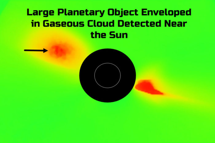 Large Planetary Object Enveloped in Gaseous Cloud Detected Near the Sun